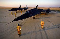 Lockheed Martin SR-71 Blackbirds on runway with pilots.