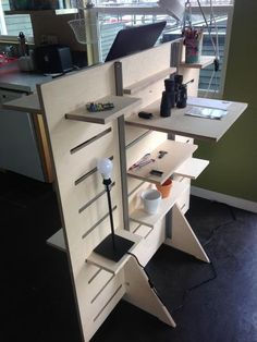 This is our standup desk with multiple configurable shelves for storage on both sides. They're made to be adjustable and versatile to match your work style, an