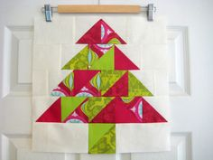 """It's time for another Christmas in July project! Get a head start on holiday fun throughout the """"lazy days"""" of summer. Christen from Love By Hand designed a Christmas Tree block and table runner featuring the ever-popular half square triangle (HST). Christmas Tree On Table, Christmas In July, Holiday Fun, Christmas Sewing, Christmas Crafts, Christmas Ideas, Christmas Quilting, Christmas Goodies, Christmas Ornament"""