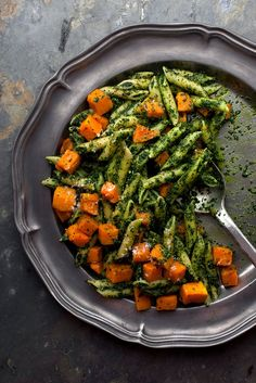 Here is a one-pot meal designed explicitly for the hungriness of a long-distance runner, with garlicky kale pesto and sweet roasted butternut squash Making the pesto with kale instead of basil gives it a structure the basil-rich original lacks, and it interacts beautifully with the crisp-and-soft smoothness of the roasted squash A terrific dish