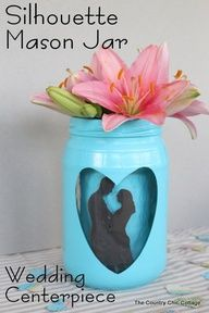 Silhouette Mason Jar for Weddings -- add a great kissing couple silhouette to a mason jar for a fun wedding centerpiece that your guests will remember!  Image Source