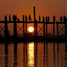 Sunset at U Pein Bridge,Myanmar.  It is a 1.2 km long bridge built entirely out of teak wood with not a piece of iron when it's first built in 1850. It is the oldest and longest teak wood bridge in the world,