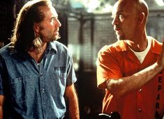 Nicolas Cage and John Malkovich in the 1997 film adaption of Con Air. Davenport Theatrical have confirmed these actors will be replaced by Chad Kroeger and Carlos Santana in the musical
