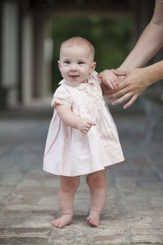 Precious little Maggie in her grandmother's vintage Feltman Brothers dress from 1959!! How sweet is she?! http://feltmanbrothers.com  (Photo by Megan Babin Photography)