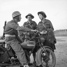 BRITISH ARMY NORMANDY 1944 (B 8154)   L/Cpl E Martin of the Corps of Military Police sits astride his motorcycle and chats to Cpl Joyce Collins and L/Cpl Celia Strong, ATS clerks at 21st Army Group HQ, Normandy, 28 July 1944.