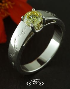 Custom 14kt warm white gold mounting holding a 4-prong set round brilliant cut fancy yellow diamond in a 'U' shape head. Open triangular panels on side face. Engrave mountain range detail on shoulders. - See more at: http://www.greenlakejewelry.com/gallery/cust_gallery.aspx?ImageID=%2097676#sthash.sW8YClXY.dpuf