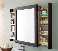 A clever bath mirror with side pull out shelves that let users access items without interrupting their looking glass view. http://hative.com/clever-bathroom-storage-ideas/