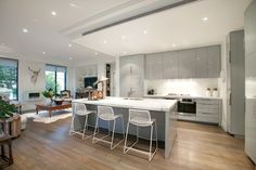 A state of the art gourmet kitchen featuring Carrara marble benches, premium Miele appliances, integrated fridge/freezer and a butler's pantry - Exceptional!