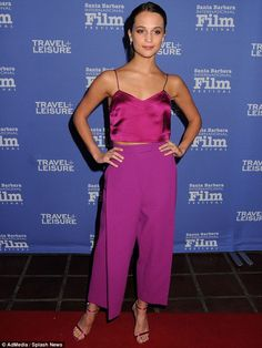 Her favorite color? The 27-year-old wowed on the red carpet at the event in a sophisticated fuchsia-themed ensemble