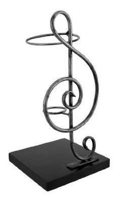 Metal Treble Clef Single Wine Bottle Display by Things2Die4. $24.99. 11 3/4 in. Tall, 6 in. X 6 in. Base. Metal/Wood. Great Gift. Good music and a good bottle of wine complement one another, and this single bottle holder is sure to complement most any decor. Made of metal, it measures 11 3/4 inches tall and has a 6 inch X 6 inch black wooden base. The bottom of the base has foam pads to prevent it from scratching delicate surfaces, so you can display it anywhere i...