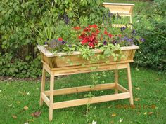 Tall Outdoor Wooden Planter Flower Box by ZimWoodworking on Etsy https://www.etsy.com/listing/117730198/tall-outdoor-wooden-planter-flower-box
