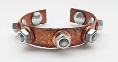 Unisex hammered copper cuff with stainless steel screws and nuts.