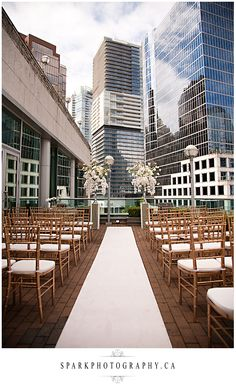 Outdoor Wedding Ceremony on Rooftop Patio with Vancouver Skyscrapers in Background (at Terminal City Club)