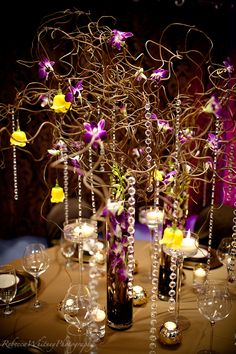 Orchids, branches, and crystals centerpiece