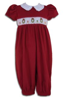 "This girls Christmas red jumper is hand smocked and embroidered in baby cordurouy with detailed collar and beautiful white sash to finish off that elegant look. It is sure to put a smile on your face as you see your little princess ""jump"" around the tree in this jumper,  get yours at www.carouselwear.com"