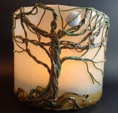 Translucent candle holder with trees