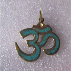LUCKY CHARM YOGA JEWEL OM OHM PENDANT AUSPICIOUS HINDU OM PENDANT YOGA JEWEL BUDDHISM OM IN GOLD LOOK     Om or Aum is of paramount importance in Hinduism. Om is a mantra and mystical sound of Hindu origin, sacred and important in various Dharmic religions. • Made of Brass, in Gold look     • Hand made with excellent finish    • 1.3 inches long & 1.2 inches wide    • Made of Brass, heavy, 0.1 oz / 8.5 gm   •  Made by highly skilled artist in Nepal Jewelry Necklaces
