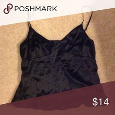 Empress Tank Top - 100% Silk Shiny and smooth.  Side zipper creates a great silhouette when worn.  This shirt is made of 100% silk.  Fits more like a 12. Express Tops Tank Tops