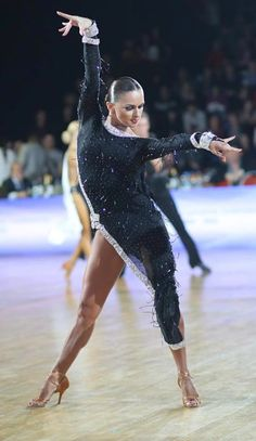 Anna Kuzminskaya from 2013. Visit http://ballroomguide.com/workshop/latin.html for info about Latin workshops from the pros.