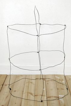Trendenser -  Make a light fixture out of wire, cover with cloth (something not flammable, I hope) and add light and cord.