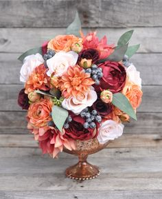 Make your own fall wedding floral designs.  Follow Holly's Wedding Designs and DIY with silk flowers from Afloral.com.