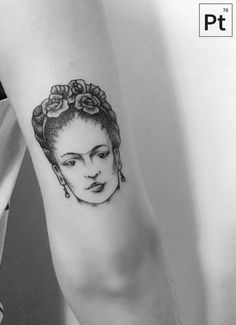 Frida Kahlo tattoo on the back of the right arm.