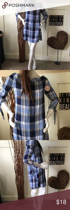 SO plaid off shoulder tunic/dress SO plaid On or off shoulder dress. This cute plaid dress has splits on the sides.   It can be worn as a tunic over Leggins, or with your favorite tights.   If you prefer it can be worn all by itself    The arms have pretty ties too.   However you choise to wear it, this pretty tunic/dress is  perfect for fall! SO Dresses Mini
