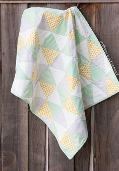 Yellow, grey, and mint triangle quilt