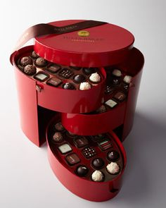 Julia Baker's signature Red Hat Box available at Neiman Marcus with three tiers of an assortment of signature handcrafted luxurious chocolates. I just adore the shape and intrinsic design of the hat box. Fabulous for any discerning chocolate lover.