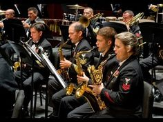 Symphony No. 4 by David Maslanka United States Navy Concert Band, 2010  It's a long piece but the ending to this symphony is great!