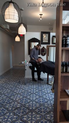 Find Villa Lagoon Tile in DC's hottest gentleman's salon, Barber of Hell's Bottom.This handsome barber shop features raw, white-washed brick walls, and beautiful cement tile from Villa Lagoon Tile. They chose our Roseton pattern in custom blues and whites.