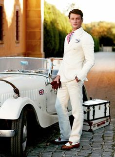 Roaring 20s style. White suit, red tie and white custom dress shirt and white car....
