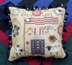 This darling pin cushion is stitched on 32 count linen. Over dyed threads, ribbon, beads, and buttons complete this sweet pincushion