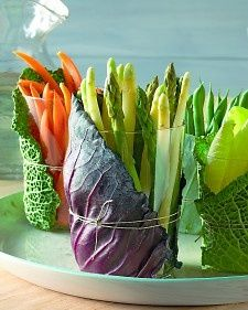 A rustic and unique way to display vegetables crudite/salad at the buffet - dip then in a hollowed out cabbage