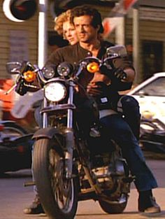 Sylvester Stallone (Cobra) and Brigitte Nielsen on a motorcycle