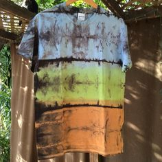 Mens Premium Shibori tie dye T- shirt ,size medium Hand dyed in blue, green, brown fade with a black shibori landscape design . Please contact me with questions. This is a Premium fruit of the loom cotton t-shirt. size medium.. chest 38 to 40  The shipping is $4.99 in the USA and $14.99 international. Thank you for your interest
