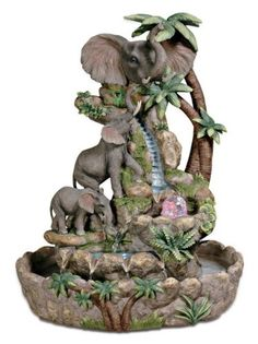 Decorate a console table or mantel with the Elephant Table Fountain. This unique polyresin piece features a colorful, detailed sculpture of elephants frolicking in a pool of water. Display it among pi Elephant Table, Elephant Home Decor, Elephant Love, Elephant Art, Elephant Nursery, Elephant Decorations, Elephant Stuff, Indoor Waterfall Fountain, Indoor Water Fountains