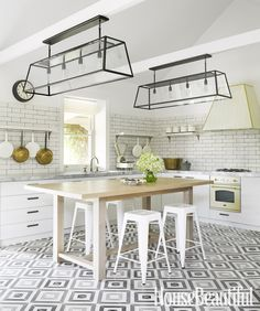 Diamond Tiles  Greg Natale hung pots from cantilevered shelves and chose Turkish terrazzo tiles to create a graphic floor.