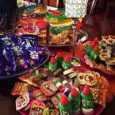 """Mexican/ Fiesta Candy Bar w/ chalkboard sign saying """"disfruten"""" and a Mexican table cloth with my paper banners above it! Mexican Candy Table, Mexican Snacks, Mexican Party Decorations, Mexican Fiesta Party, Fiesta Theme Party, Festa Party, Party Themes, Party Ideas, Theme Parties"""