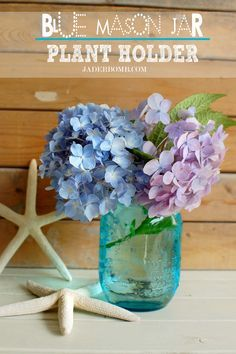 glass jars with flowers christening - Google Search