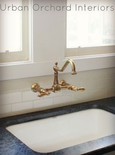 Unlacquered Brass Faucet And Soapstone Countertops.