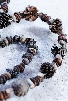 Winter ~ Advent ~ Week Two: The Light of Plant & Branch ~ Natural Garland ~ Drill or make holes in pinecones, acorns, acorn tops, and other found treasures and string together