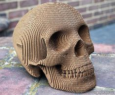Does your home or office lacks decoration? Well, this cardboard human skull made from 50 layers of cardboard paper will be a very good choice. It looks incredibly real, and the layered appearance gives it a unique and modern look. The producers named this skull Vince and is made entirely of recycled card-board, non-toxic, thus environmentally friendly. It comes packaged flat for shipping, but it contains detailed instructions on how to asse ..
