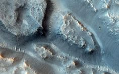 Many valleys occur all over Mars that reveal an extensive ancient history of liquid water erosion. This image from NASA's Mars Reconnaissanc...