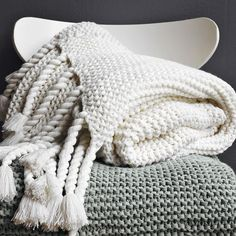 I love these throws from West Elm! We can't get them though - too many tassels to tempt the kitten!
