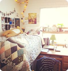I love that body pillow. I love the blanket and the wall art. Even the desk is simple and organized!