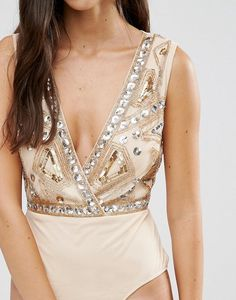 Bookmark this to see 16 gorgeous fall bodysuits that will have you looking your autumn's best.