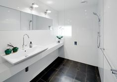 Second contemporary bathroom with basalt floor and Tolomeo lights. Brooke Aitken Design