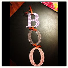 Halloween B-O-O door hanging sign! Glue scrapbook paper on wooden letters with Modge Podge! And hang them together with ribbon! Pretty easy project if your not that crafty like myself! It's a start!