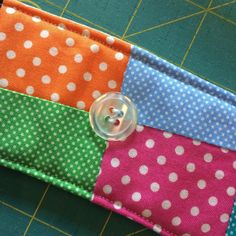 My friends over at the Fat Quarter Shop have a new pattern, and it's adorable!  The Coffee Koozie is perfect for the always adorable mini-charm packs (2 1/2″ squares). I can see them as great gifts, and they are so fast to make too! I made it in about a half hour, and it will definitely be faster next time! The fabrics used are Dottie by Moda, which are cheery and bright, or pretty neutral depending on your preferences. One mini charm pack could make 3 koozies.
